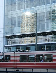 building reflection over tram