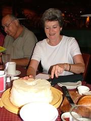 Still slicing birthday cake
