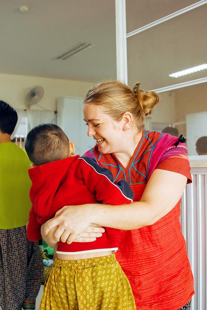 Mary hugs child in school