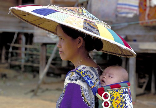 Woman carries an infant | by World Bank Photo Collection