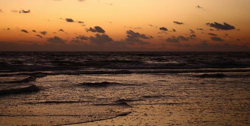 sea sky clouds sunrise warm colours atlantic
