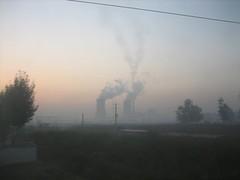 Smoking factories along China rail road   by IsaacMao