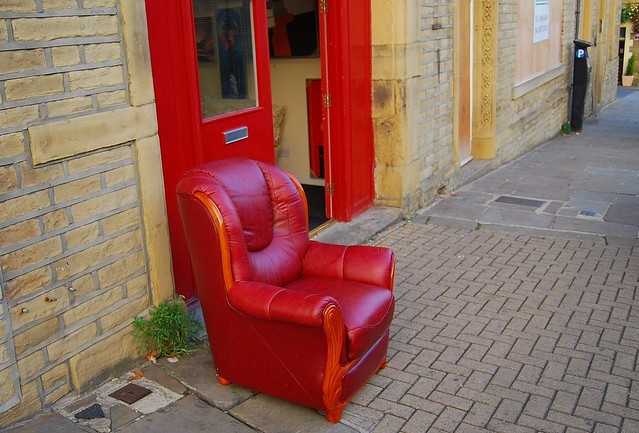 Red chair on the pavement