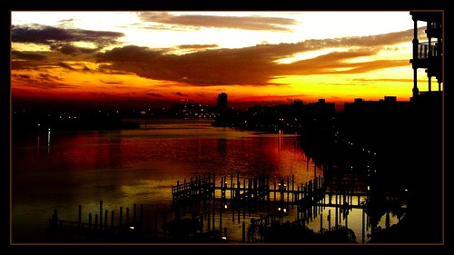 lighting travel sky sun reflection water silhouette clouds sunrise effects scenery florida perspective scenic structures myfavorites viewpoint enhanced abigfave superbmasterpiece florida2008