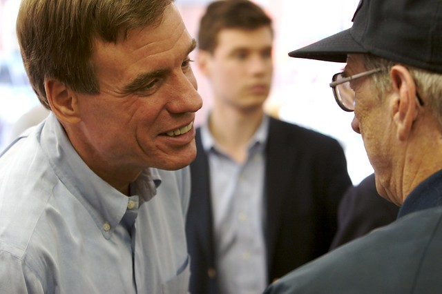 Mark Warner with a voter