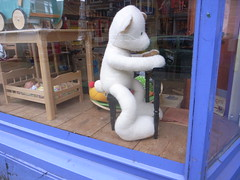 white bear in toy store window