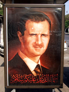 Bus-stop poster of Bashar al-Assad | by delayed gratification