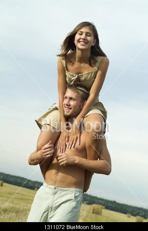 Woman riding a man