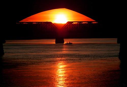 sunset reflections river boats bravo fishermen