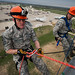 Chief Master Sgt. of the Air Force James Cody, left, prepares to rappel down a 90-foot tower with Senior Airman Cody Carson, 312th Training Squadron firefighting student, center, and Chief Master Sgt. Thomas F. Good, 17th Training Wing command chief, right, at the Louis F. Garland Department of Defense Fire Academy on Goodfellow Air Force Base, Texas, April 3, 2015. Cody toured the fire academy and observed different aspects of fire protection training while visiting with staff and students. (U.S. Air Force photo by Airman 1st Class Devin Boyer/Released)