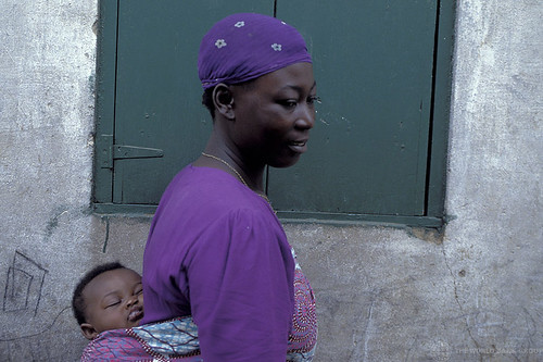 Mother carrying child. Ghana