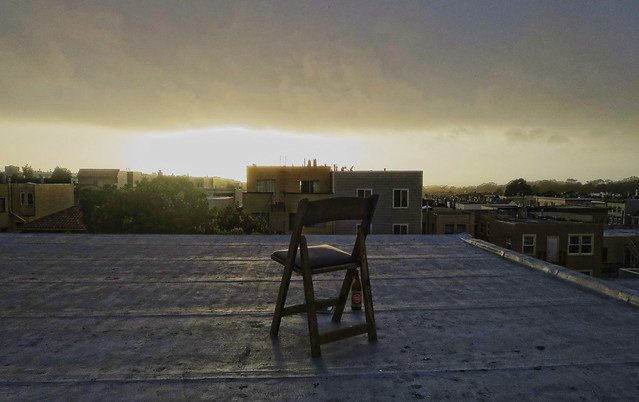 chair on the roof with a book and a beer at sunset; 1333 26th ave, San Francisco (2014)