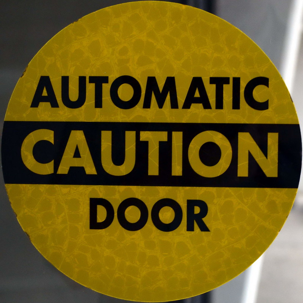 Automatic caution door