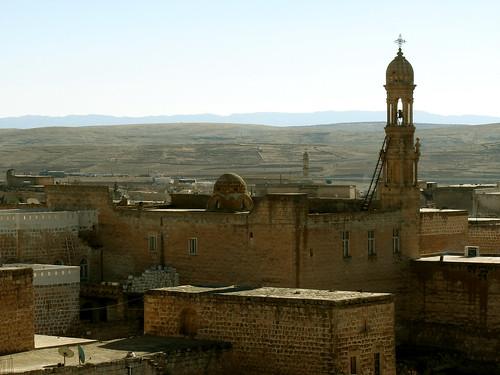 Midyat and Syriac-Orthodox St. Akhsnoyo church   by Senol Demir