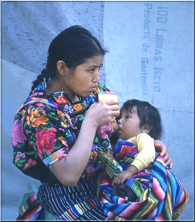 Mother with child . Market in Chi Chi Castenango