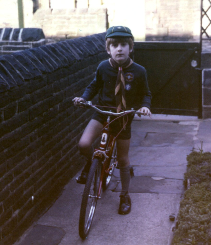 Cliff in cub scout uniform on new bike 1976 | Clifford Raw