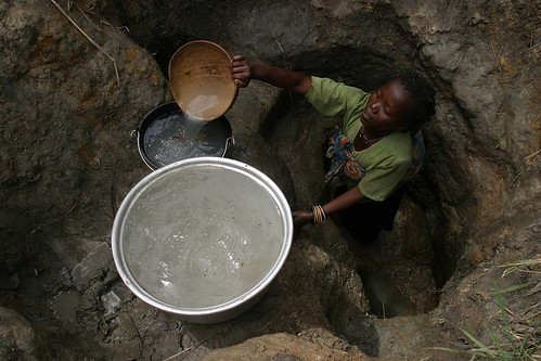 Woman with child collecting water | by hdptcar