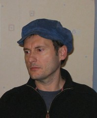 Laurent dons a blue beanie-like hat
