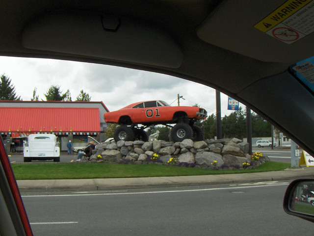 General Lee with monster truck tires on a pile of rocks | Flickr