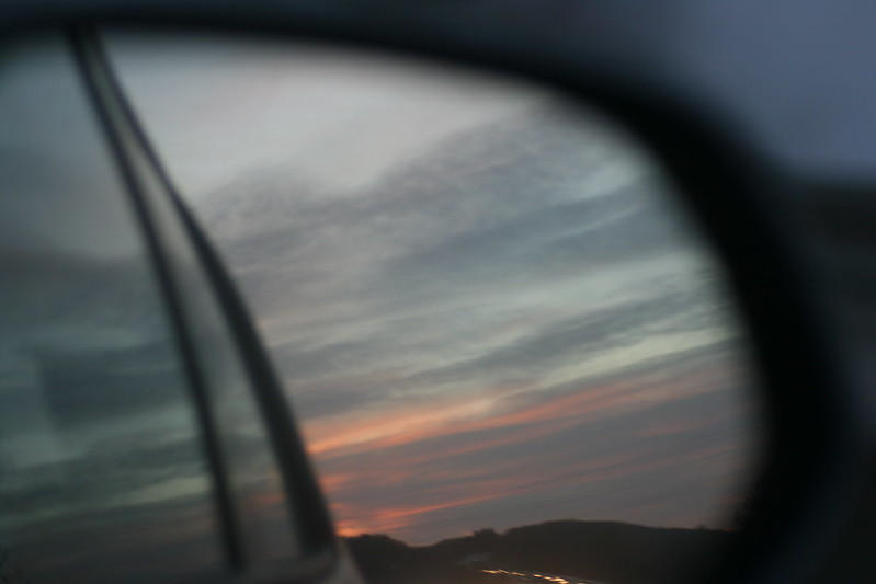 Sunset in a rearview mirror