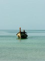 Long tail boat approaching Tub Kaek Beach near Krabi, Thailand