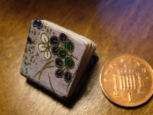 miniature book and penny