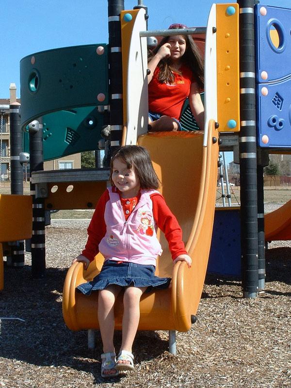 Laurel showing Sarah the playground