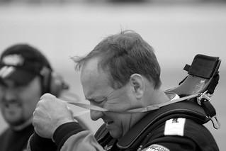 Ken Schrader unfastens his HANS device   by sidehike