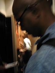 Taylor behind door