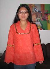 Orange tunic with gold sequin trim