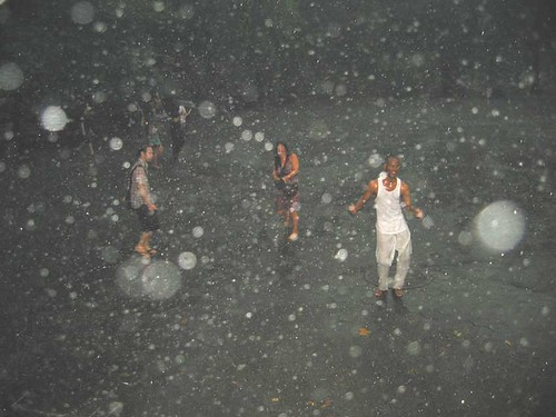 People dancing in the rain near the Central Park Bandshell