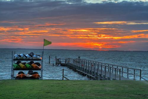 sunset red sun beach evening duck kayak flag northcarolina farewell boardwalk goodbye obx