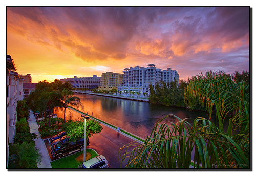 pink sunset orange clouds canal florida balcony handheld hdr aventura canonefs1022mmf3545usm blueribbonwinner supershot orangeskies 3exp fineartphotos platinumphoto anawesomeshot goldenphotographer brillianteyejewel miamidadeco betterthangood dphdr villagebythebay theviewlookingwest