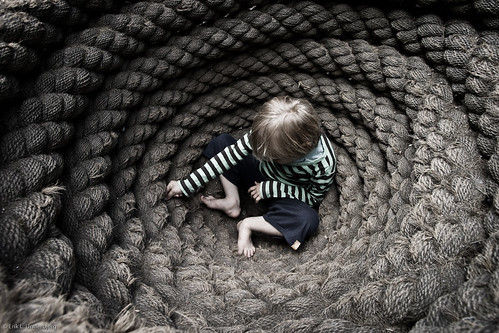 Little boy in a pot of ropes | by wonderbjerg