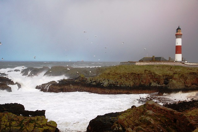 Waves breaking over the rocks at Buchan Ness