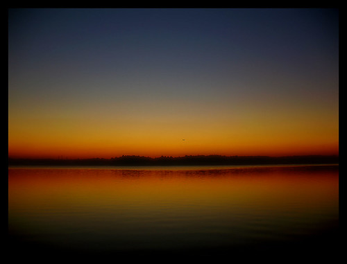 chrysti northcarolina lakecrabtree lake crabtree raleigh morrissville morrisville nc sunset airplane reflection stripes horizon blue orange red gold evening night trees landscape twilight water glow light nature color vivid muted abstract naturesfinest platinumphoto
