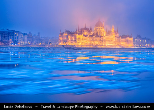 Hungary - Budapest - Hungarian Parliament Building - Iconic landmark reflected at Danube River full of floating ice | by © Lucie Debelkova / www.luciedebelkova.com