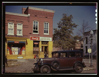 [Shulman's Market at the southeast corner of N Street and Union Street S.W., Washington, D.C., with a 1931 Chevrolet car parked in front]  (LOC) | by The Library of Congress