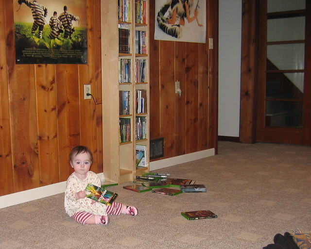 Zoe playing with DVDs