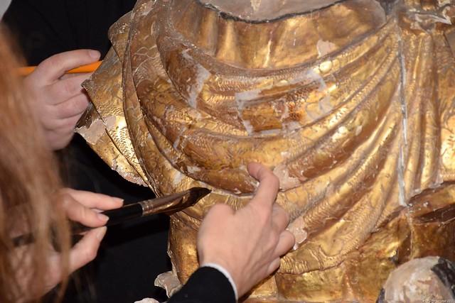 Le buste reliquaire de Saint Donat D'Arezzo a été sélectionné grâce au travail de Régis Mineï pour l'association Seï Sacoulié pour bénéficier d'un mécénat de conservation-restauration dans le cadre du concours organisé par le Commissariat à l'Énergie Atomique et l'Association des Maires de France. La première étape de cette restauration a consisté à renforcer le reliquaire avant son transport.  À cette occasion, l'association ARC-Nucléart a procédé à la pose de papiers de conservation sur les principaux soulèvements de la couche picturale afin d'éviter les pertes d'écailles fragilisées, ainsi qu'au conditionnement de la sculpture pour permettre le transport de l'œuvre dans les meilleures conditions.  Le buste a ensuite été transporté à Grenoble afin de commencer le travail de restauration mené durant une année par l'équipe de l'association ARC-Nucléart.