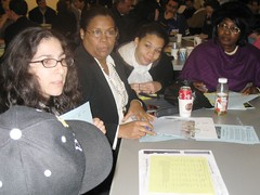 Danielle listens to community members' concerns about the five proposals for the Rail Yards.