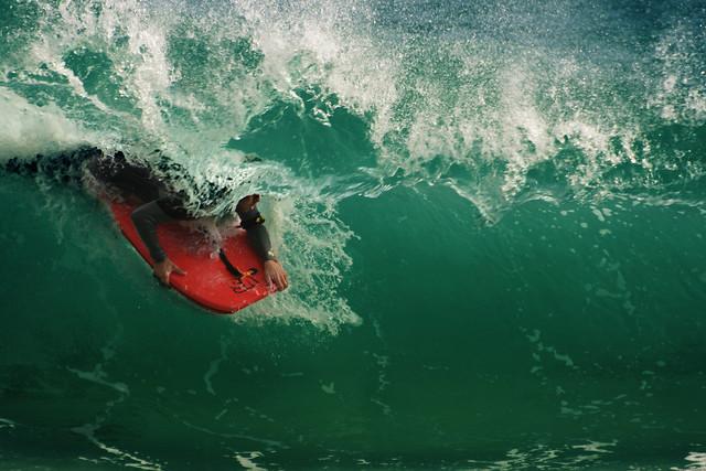 Emerging - Unknown Bodyboard rider at  Porthcurno Beach, Cornwall, UK