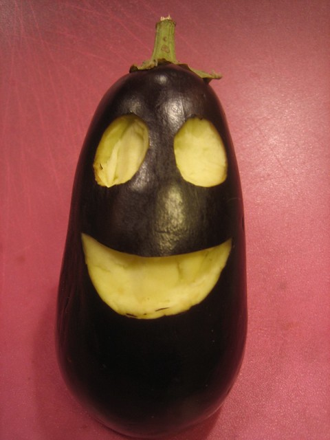 Smiley face eggplant'o'lantern
