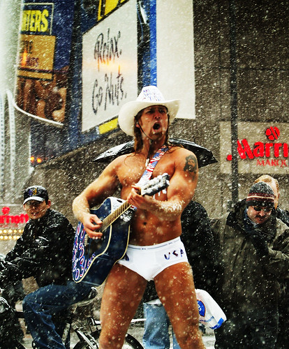 """The Naked Cowboy"" plays his guitar in Times Square"