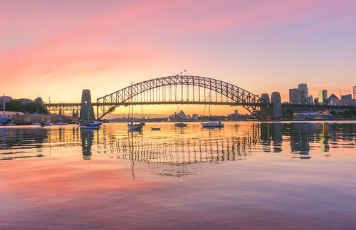 aussie australia bridge city cityscape cloud cloudscape cloudy dawn dusk evening harbor harbour harbourbridge horizontal landmark landscape newsouthwales nsw reflection sunlight sunrise sunset sydney travel twilight water