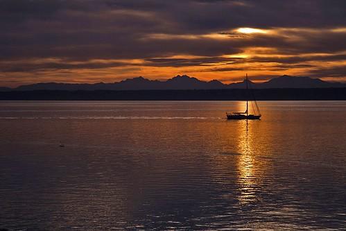 clouds sailboat sunrise cascades pugetsound