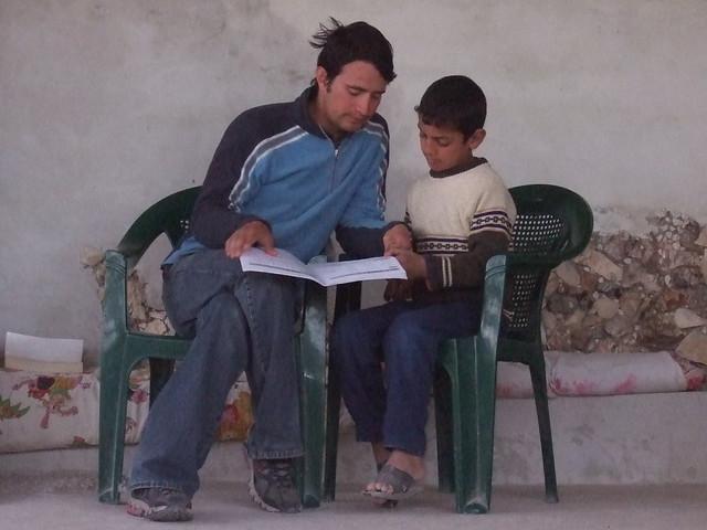 Jonathan gives English lesson to Palestinian child