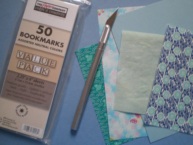 Blank bookmarks + exacto + paper + cotton yarn