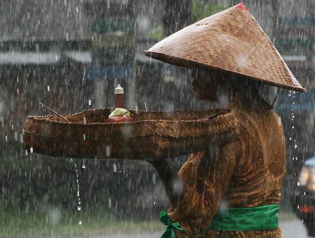 rain woman Bali Indonesia
