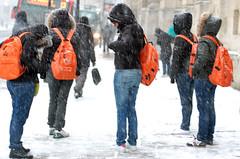 Orange backpacks by Richard Holden